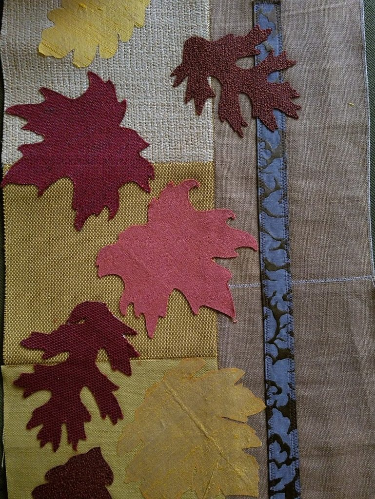 Fusing fall leaves onto quilt