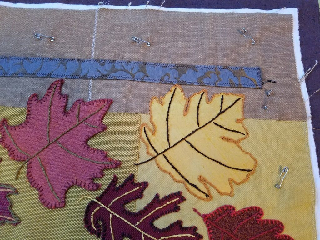 Falling Leaves art quilt sandwiched for quilting