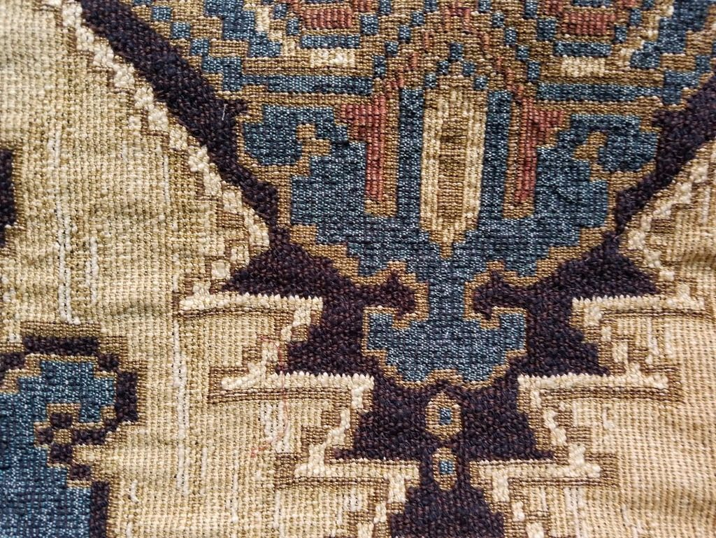 Beautiful, rich blue and beige fabric swatch