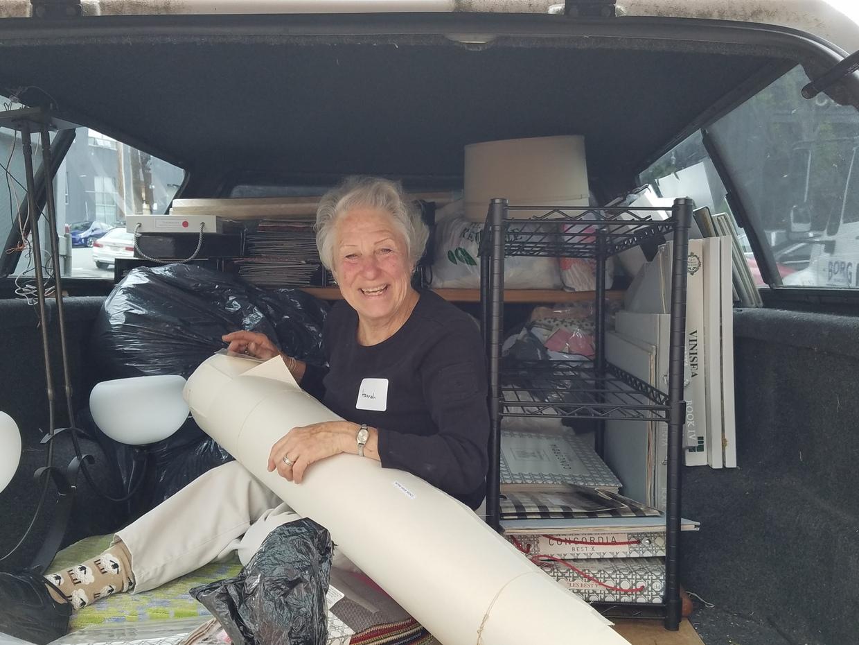 Hannah organizing the half-loaded truck