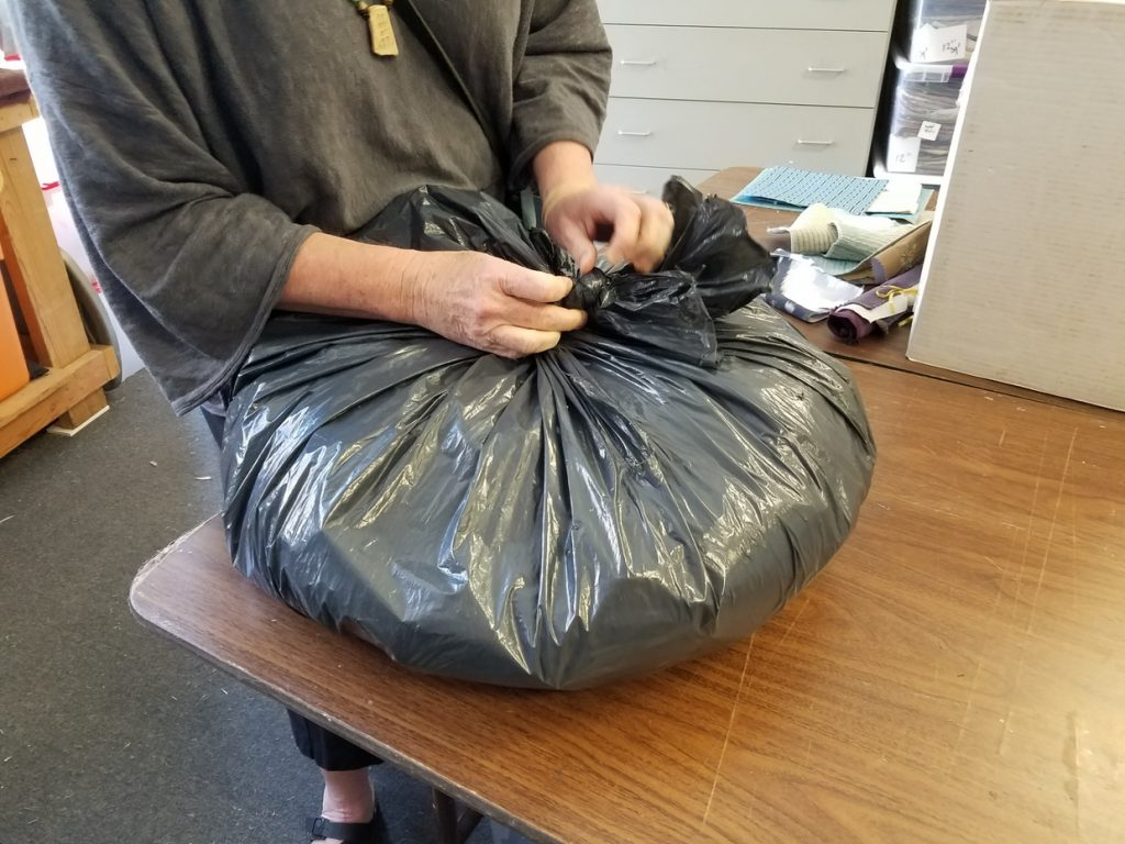 Opening fabric bags at FabMo's facility