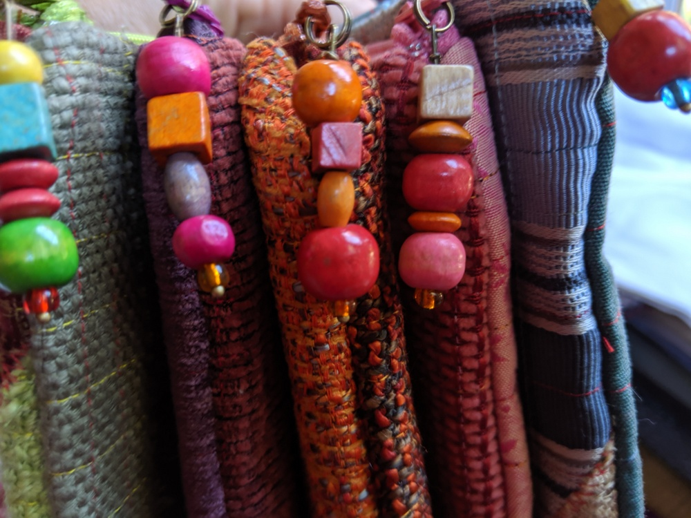 Colorful zipper pulls for colorful pouches