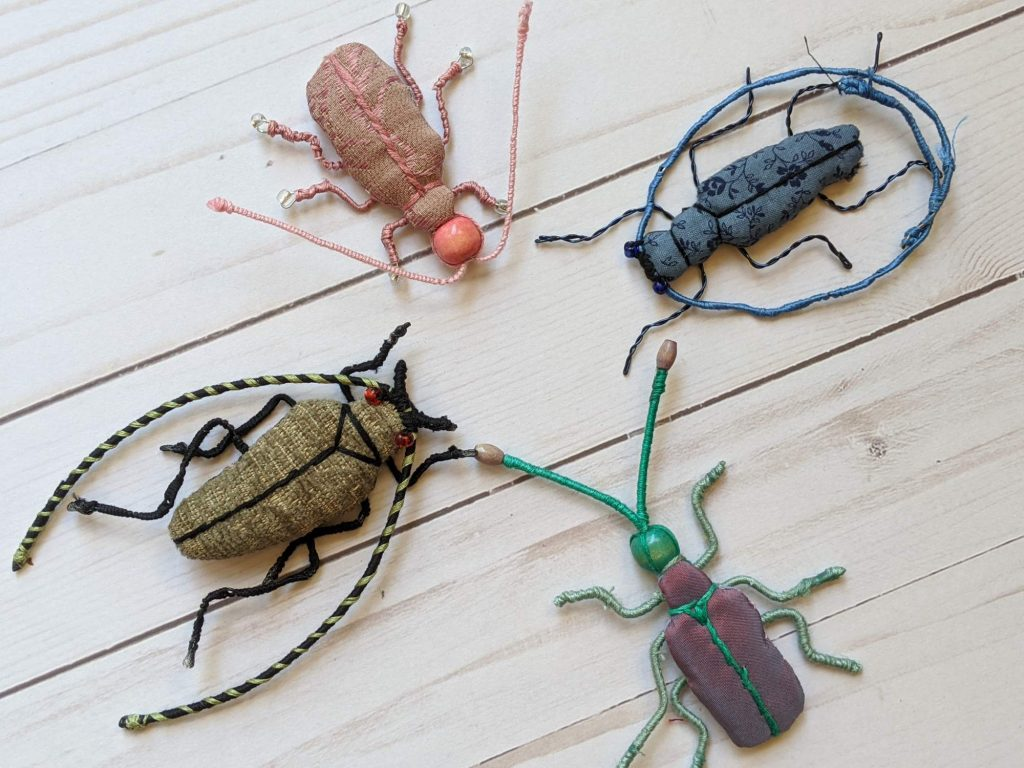 Four fabric beetles